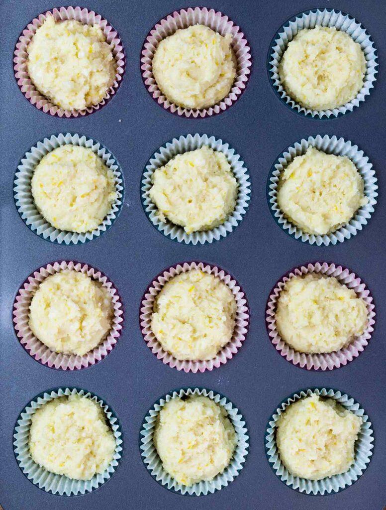 lemon ricotta muffins batter on muffin pan