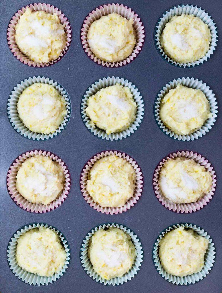 lemon ricotta muffins batter with sugar