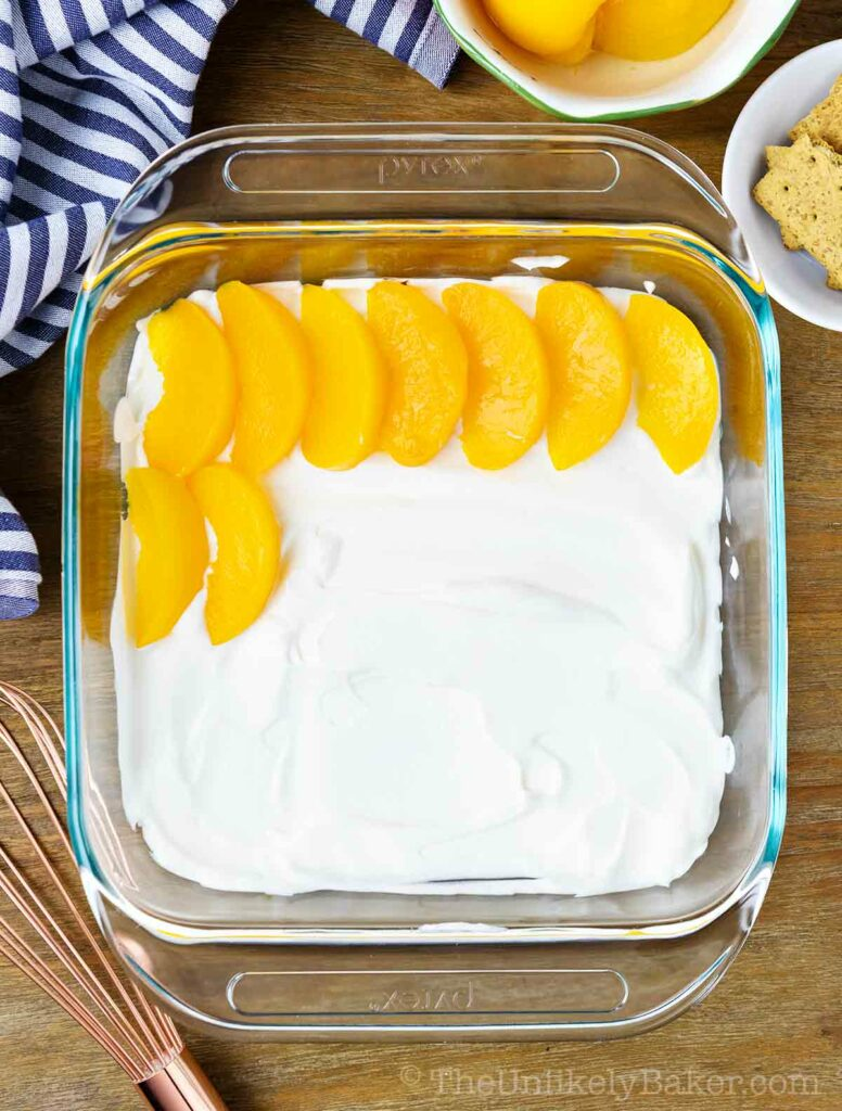 arrange peach slices on top of cream