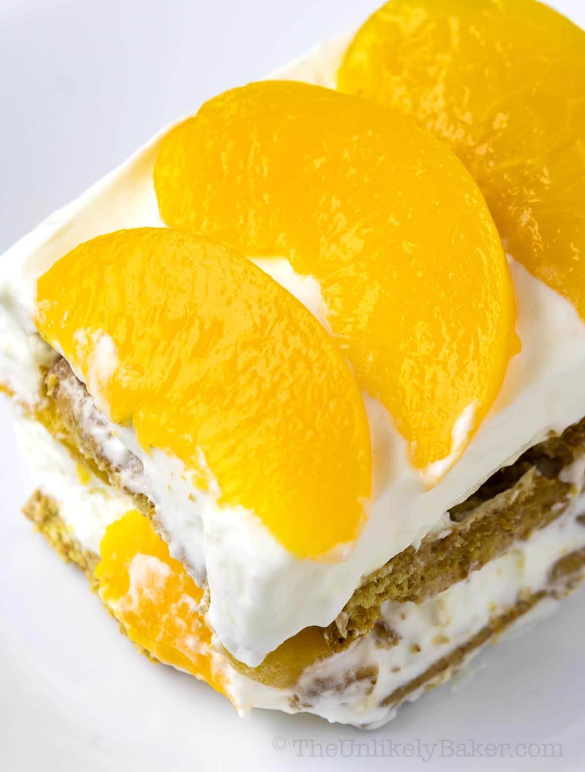 close up shot of peach icebox cake slice