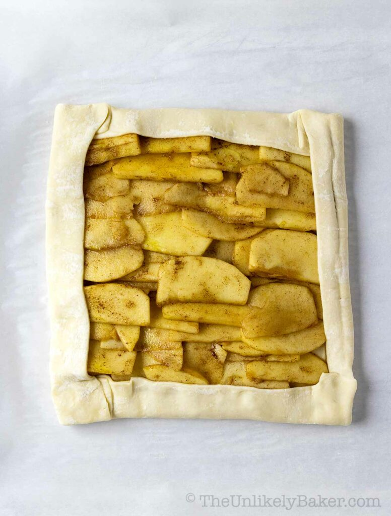 Fold puff pastry over apple slices